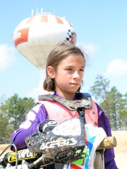 Brighton Richards, 8, of Egg Harbor Township, takes a break from riding her motorcycle at the Field of Dreams motocross track in Millville on Friday.