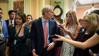 Sen. Rob Portman fields questions from the press about the upcoming health care vote in the U.S. Capitol on July 20, 2017.