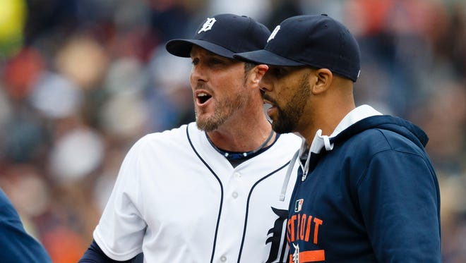 Detroit Tigers relief pitcher Joe Nathan, left, and starting pitcher David Price celebrate after a game against the Minnesota Twins at Comerica Park.