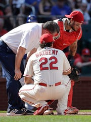 Yadier Molina struggles after being hit in the groin