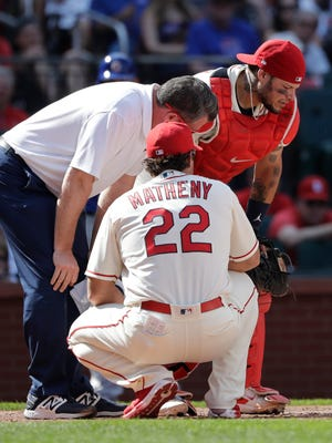 Yadier Molina struggles after being hit in the groin by a foul-tipped, 102-mph fastball.