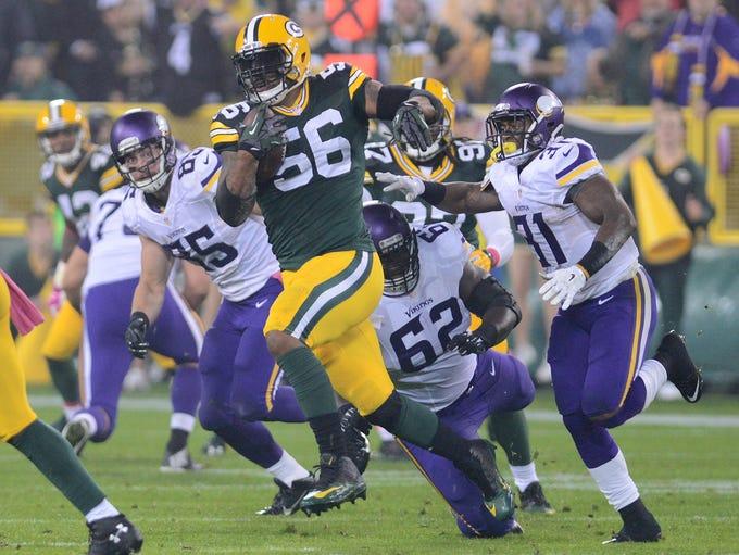 Green Bay Packers linebacker Julius Peppers (56) runs