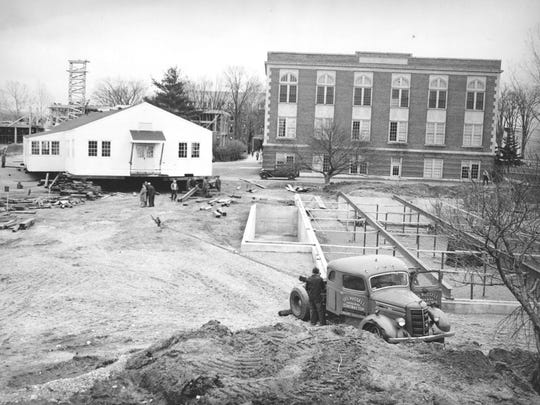 Klein Hall is shown here on the left circa 1949 just before placement onto the foundation where it still stands. Through the years it has served as library, Student Center, and housed a myriad of administrative offices. It is the only remaining military surplus building on the main campus.