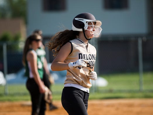 Delone's Shelbee Holcomb rounds the bases during the