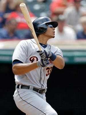 Detroit Tigers' Steven Moya watches his ball after hitting a two-run single off Cleveland Indians relief pitcher TJ House in the seventh inning of a baseball game, Wednesday, July 6, 2016, in Cleveland. Miguel Cabrera and Nick Castellanos scored on the play. (AP Photo/Tony Dejak)