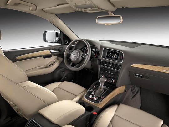 The interior of the 2014 Audi Q5 is all about understated class, laden with real wood, but focused on giving drivers what they need. Our test vehicle came with a panoramic roof, fold-flat rear seats with armrest pass-through, tri-zone automatic climate control, power hatch and Bluetooth phone/streaming audio.