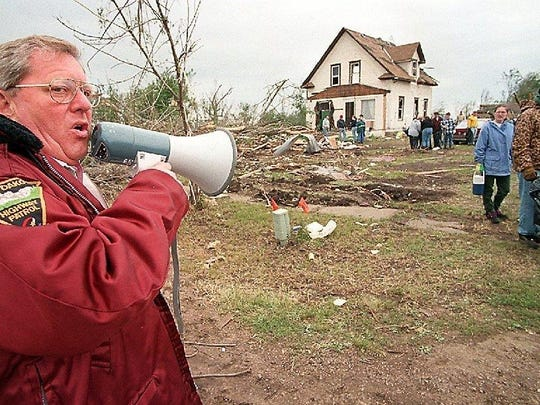 Gov. Bill Janklow is remembered as a strong executive. In this photo, the governor directs rescue crews after a tornado in 1998 hit Spencer, S.D., killing six people. Janklow was one of the first to arrive and camped out of a motor home in town while leading relief efforts.