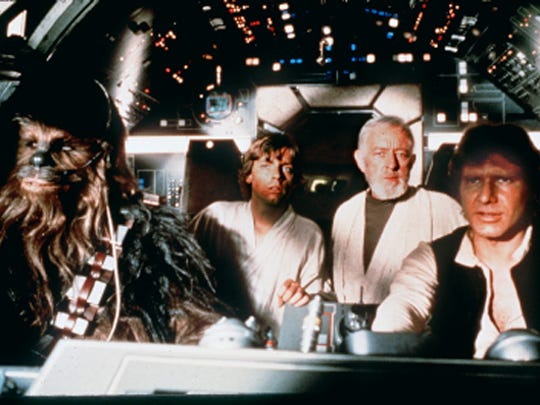 """From left, Peter Mayhew, Mark Hamill, Alec Guiness and Harrison Ford in """"Star Wars."""""""