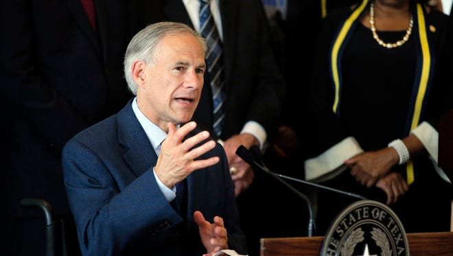 """In this Friday, July 8, 2016 file photo, Texas Gov. Greg Abbott, right, responds to questions about the police shootings during a news conference at City Hall in Dallas. Spokesman Matt Hirsch said Sunday that Abbott was in Jackson Hole, Wyo., Thursday when he was scalded in an accident involving hot water. He sustained """"extensive second- and third-degree burns"""" on both legs below the knees and on both feet and could miss next week's Republican National Convention. Abbott held the press conference in Dallas on Friday, but didn't disclose being burned."""