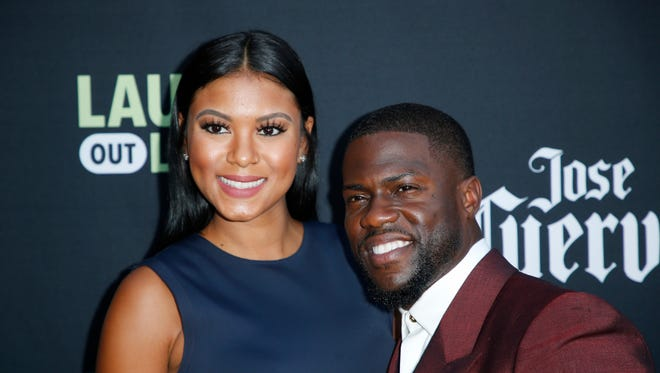 Comedian Kevin Hart  and his pregnant wife, Eniko Parrish, arrive at Hart's 'Laugh Out Loud' streaming video network launch event in Beverly Hills in August.