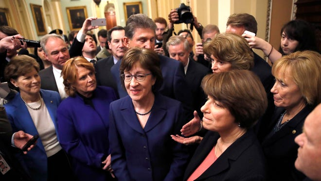 Following a procedural vote aimed at reopening the government in January, Sen. Susan Collins, R-Maine, center, was praised by her fellow lawmakers for leading the bipartisan effort.  Sen. Amy Klobuchar, D-Minn., is at front right.