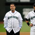 July 16, 2011; Seattle, WA, USA; Seattle Mariners former player Edgar Martinez (left) stands with current right fielder Ichiro Suzuki before a game with the Texas Rangers at Safeco Field. The game was in celebration of the  2001 won team won 115 regular season games.  Mandatory Credit: James Snook-USA TODAY Sports