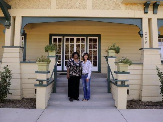 Francies Torrence, 66, left, and Marla Leal, 57, volunteer as teachers at Grandma's House in Tulare.