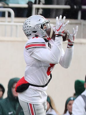 OSU's Gareon Conley intercepts the pass from MSU's Tyler O'Connor during the fourth quarter at Spartan Stadium on November 19, 2016 in East Lansing, Michigan. Ohio State defeated Michigan State 17-16.