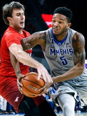 University of Memphis guard Markel Crawford (right) drives for a layup against Southern Methodist University defender Jonathan Wilfong (left) during second half action at Moody Coliseum in Dallas, Texas.