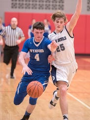 Wynford's Wyatt Smith drives past Carey's Griffin Summit.