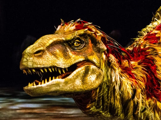 """A male Utahraptor from the theatrical production """"Walking With Dinosaurs."""""""