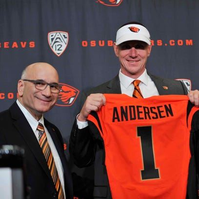 Nov 15, 2014; Corvallis, OR, USA; Oregon State Beavers new football coach Gary Andersen (center) poses for a photo with athletic director Bob De Carolis (left) and president Edward Ray during a press conference at Reser Stadium. Mandatory Credit: Susan Ragan-USA TODAY Sports