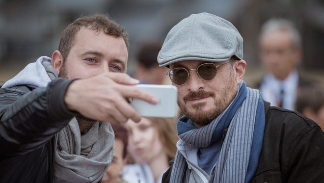 A fan poses for a selfie with director Darren Aronofsky during the Deauville American Film Festival on Sept. 8, 2017, in France.