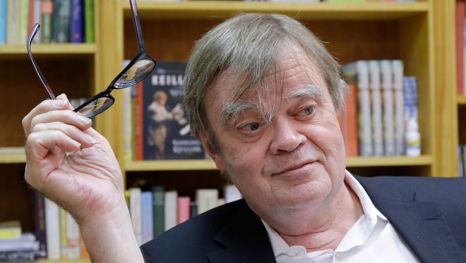 "In this April 29, 2014 Garrison Keillor appears in his St. Paul, Minn., office. Keillor will hit the road this spring to celebrate Minnesota Public Radio's 50th anniversary. Keillor says his one-man ""The Gratitude Tour"" will visit five Minnesota cities in six days in April."