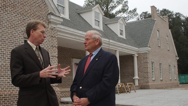 File Photo: The Rev. T. David Tribble, executive director of the Bethesda Home for Boys, discusses the final preparations for the completion of the new school building with Dick Eckburg, the capital campaign co-chairman. Dick Eckburg died t
