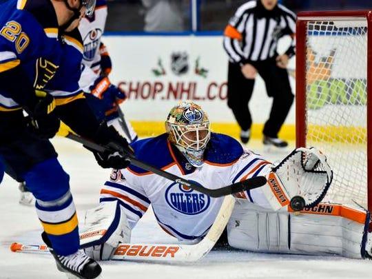 Edmonton Oilers goalie Ben Scrivens (30) blocks the