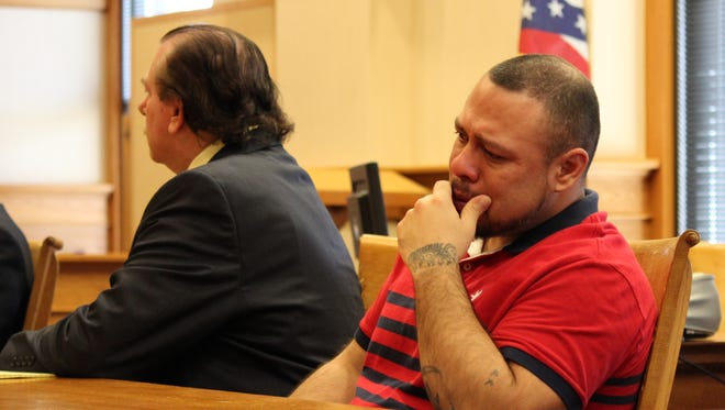 Jesus Yerena, right, listens as the jury is polled after have been found guilty on five of the seven felony counts.