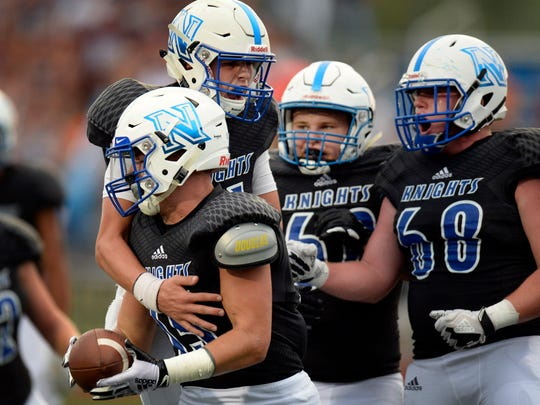 Nolensville quarterback Ryder Galardi (11), second from left, celebrate with running back Colton Dooley (15) after Dooley scored a touchdown against Page during the first half of an high school football game Friday, August 24, 2018, in Nolensville, Tenn.