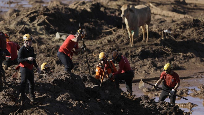Firefighters look for victims of a dam collapse in Brumadinho, Brazil, Jan. 28, 2019.