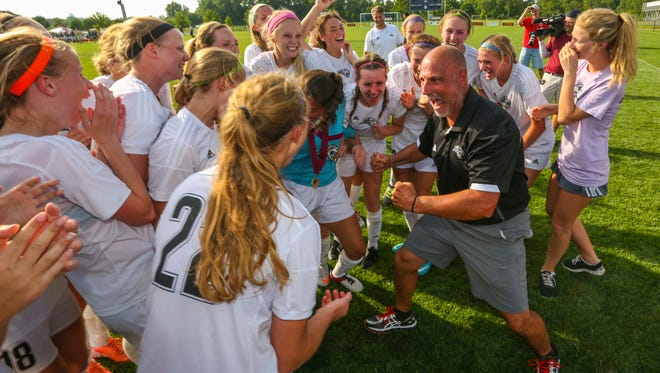 Ankeny Centennial's assistant coach Peter Rameh, right, congratulates the team on defeating Iowa City West's in their Class 3A championship at the Iowa Girls' State High School Soccer Championship Saturday, June 11, 2016, at Cownie Sports Complex in Des Moines, Iowa. Centennial defeated West High 2-1.