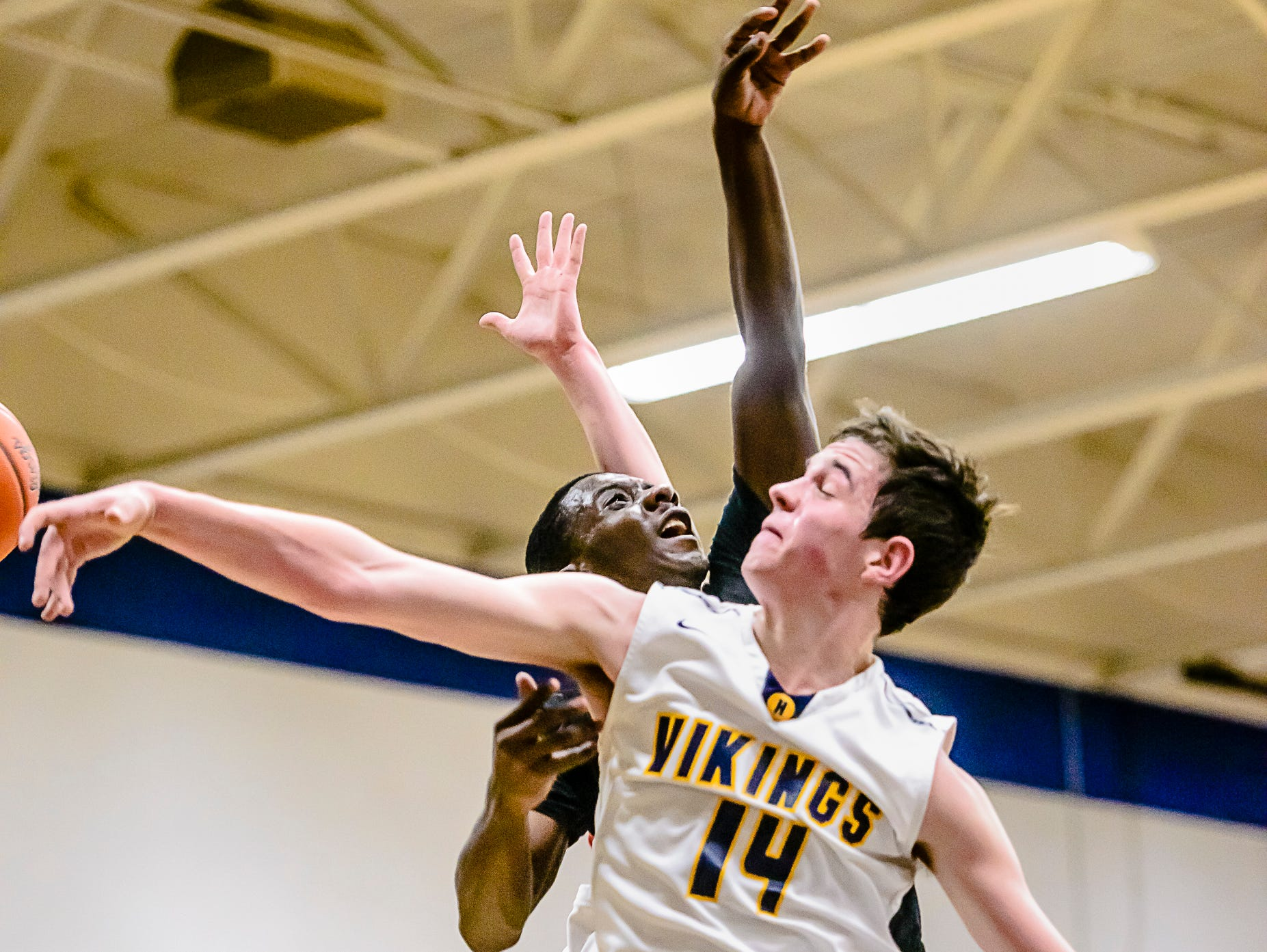 Avery McKinney ,14, of Haslett swats away a shot attempt by Keshawn Harris of Waverly during their game Friday January 20, 2017 in Haslett. KEVIN W. FOWLER PHOTO