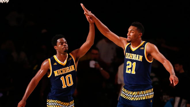 Nov 27, 2015; Paradise Island, BAHAMAS; Michigan Wolverines guard Derrick Walton Jr. (10) and guard Zak Irvin (21) celebrate the victory against the Texas Longhorns in the second half during the 2015 Battle 4 Atlantis in the Imperial Arena at the Atlantis Resort.
