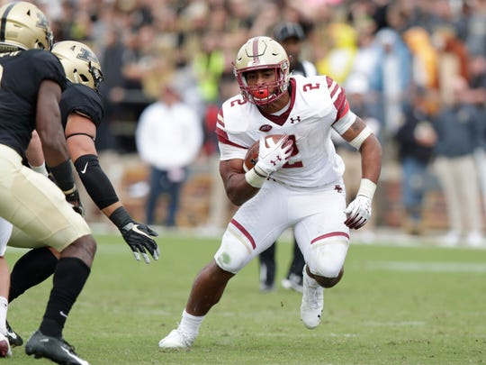 FILE - In this Sept. 22, 2018, file photo, Boston College running back AJ Dillon (2) carries against Purdue during the second half of an NCAA college football game in West Lafayette, Ind. Boston College will arrive for a game at Virginia Tech with one of the ACC's top running backs in Dillon, who averages 133.5 yards per game, to face a team that has lost essentially nine starters off last year's team and allowed 465 rushing yards--and no passing yards--when it lost 49-28 to Georgia Tech in its last outing. (AP Photo/Michael Conroy, File)