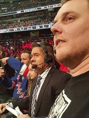 One of the Spanish announcers joined us in the crowd, standing between my friend Jonathon Knight and my wife, Charlotte.