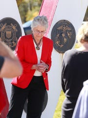 Elaine Bakkenson leads the Lord's Prayer at a ceremony honoring veterans that was organized by the Desert Gold Chapter of the Daughters of the American Revolution on Friday at Memory Gardens Cemetery in Farmington.