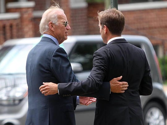 Vice President Joe Biden stands with his son, the late former Delaware Attorney General Beau Biden, who passed away May 30 after a battle with brain cancer.