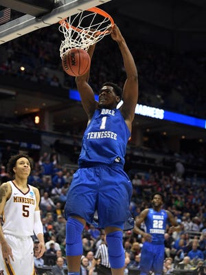 MTSU forward Brandon Walters (1) dunks the ball during the first half of the NCAA tournament game at BMO Harris Bradley Center on Thursday.