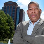 Murfreesboro City Councilman Ron Washington, who will be retiring at end of August after 18 years on the council, stands in Civic Plaza, on Wednesday July 20 2016.