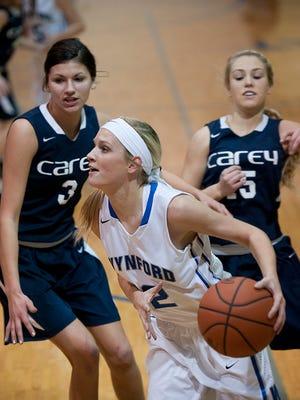 Wynford's Elle Richmond drives past Carey defenders earlier this season in W.R. Donnenwirth Gymnasium.