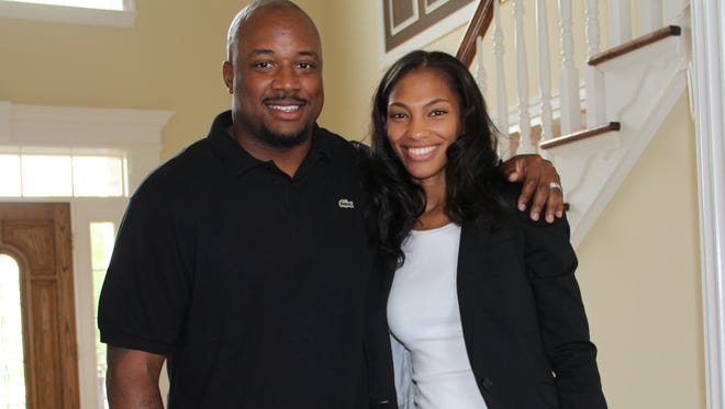 Cato June with wife Nichole and son Cato Jr.
