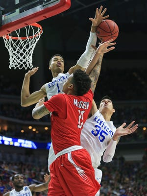 Kentucky's Skal Labissiere blocks the shot of Stony Brook's Rayshaun McGrew in the first half Thursday night in Des Moines.