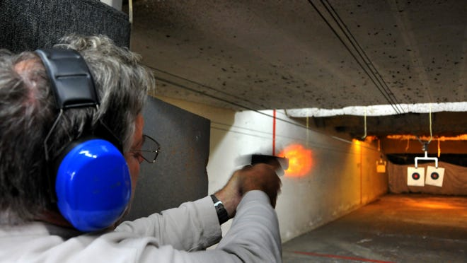 Phillip Blaha of Cape Canaveral gets some range time in at The Gun Site Range on Merritt Island, shooting with a Glock pistol.