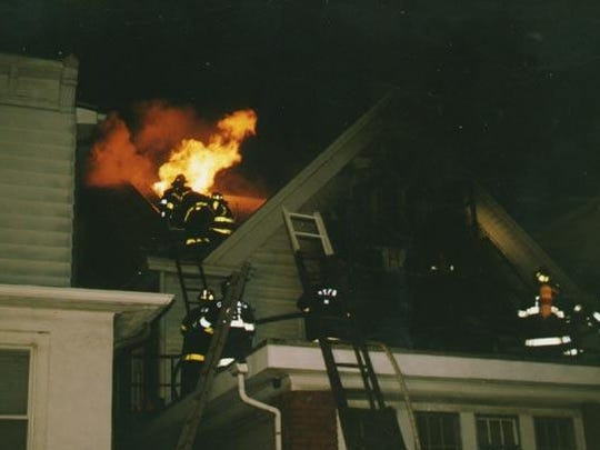 This is an archive photo of Boonton's volunteer firefighters extinguishing a mansion house in 1991. Boonton's firefighters are all volunteers; and this year, are celebrating 125 years since their department's founding.