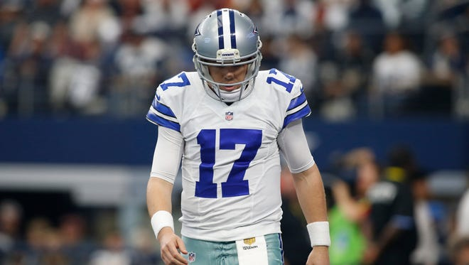 Dallas Cowboys quarterback Kellen Moore (17) leaves the field after an incomplete pass in the first quarter against the Washington Redskins at AT&T Stadium.