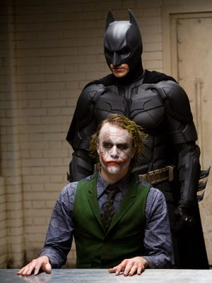 "In this image released by Warner Bros., Heath Ledger starring as The Joker, is shown in a scene with Christian Bale, starring as Batman in ""The Dark Knight."""