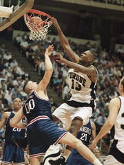 Purdue?s Glenn Robinson dunks over Kansas center Greg
