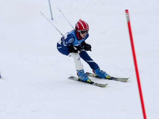 A member of the Burlington High School Alpine Ski Team captured in a race by Burlington Athletics.