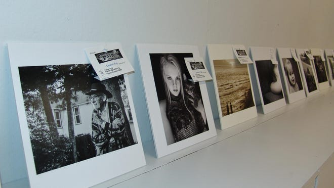 Photos are displayed Wednesday morning before the judging in the Art Hall on the Coshocton County Fairgrounds.