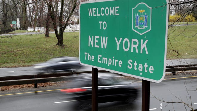 A sign welcomes motorists to New York, at its border with Connecticut, near Rye Brook, New York.