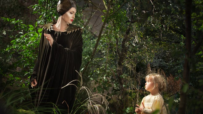 """Angelina Jolie as Maleficent, left, in a scene with her daughter Vivienne Jolie-Pitt, portraying Young Aurora, in a scene from """"Maleficent."""""""
